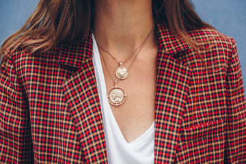 Wall Mural - fashion blogger outfit details. fashionable woman check plaid blazer, white t shirt and chunky round coin chain necklace. detail of a perfect fall fashion 2018 outfit.