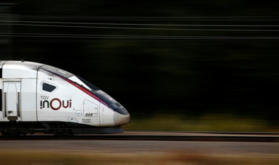 A TGV InOui high-speed train operated by state-owned railway company SNCF speeds on the LGV Atlantique railtrack outside Orsonville