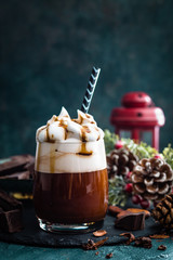 Hot chocolate with whipped cream. Chocolate drink and Christmas decorations