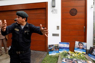 Flowers and fliers are placed outside the Nicaraguan embassy to protest against President Daniel Ortega's government in Lima