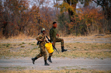 Anti poaching unit of Botswana Defence Force (BDF) react as they see the photographer in a wild life area outside Mababe