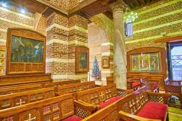 The rows of the benches in orthodox St Barbara Church in Cairo, Egypt