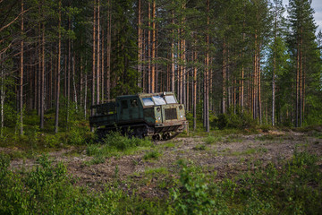 Old soviet artillery tractor by the woods
