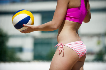 Beach Volleyball player getting ready to serve.