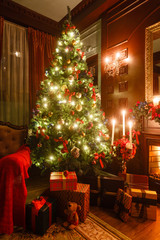 Fond de hotte en verre imprimé Montagne gifts at the Christmas tree. Christmas evening by candlelight. classic apartments with a fireplace.
