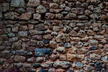 Antique wall of stones made by Incas in the Valley of Incas, Pisac, Peru