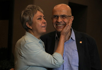 Enis Berberoglu, a lawmaker from the main opposition CHP, is seen with his wife Oya after being released from prison in Istanbul