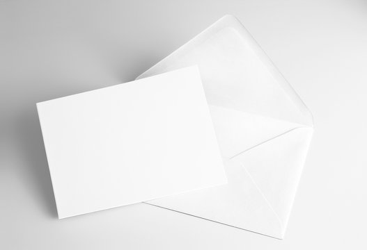 Blank folded white card and envelope
