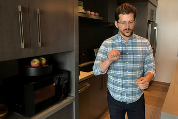 Daniel Rausch, Amazon's vice president of Alexa Smart Home, demonstrates the company's new voice-controlled microwave at company headquarters in Seattle