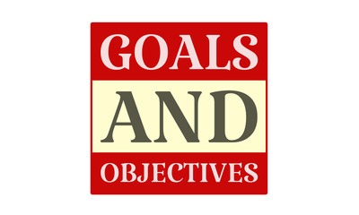 Goals And Objectives - written on red card on white background