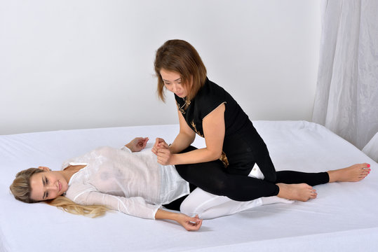 Thai Massage. Massage therapist working with woman