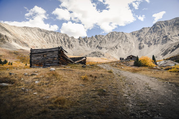 Landscape view of abandoned mining ruins at Mayflower Gulch in Colorado during autumn.