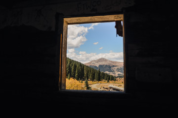A Colorado, mountain landscape seen from the inside abandoned mining ruins.