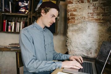 Man using laptop computer while sitting at home