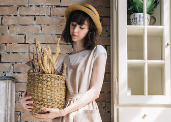 Romantic girl with basket in her hands