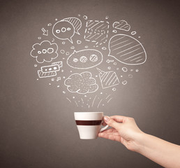 Young female hand holding coffee cup with drawn thought bubbles above it