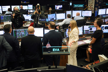 White House Senior Advisor Trump makes a call to crew members at the International Space Station during a tour of the Johnson Space Center in Houston