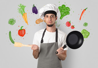Bearded cook with colourful drawn vegetables on a white wallpaper