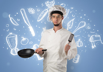 Young cook with kitchen instruments and drawn recipe concept on wallpaper