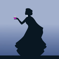Indian Woman Holding a Diwali candle.