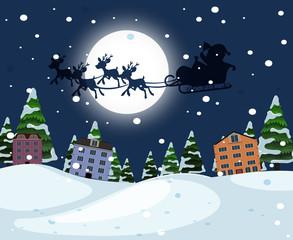 Silhouette santa riding sleigh over town