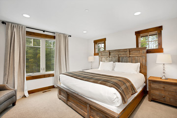 Bedroom interior with wooden bed and exit to back patio.