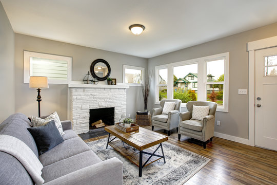 Spacious living room with traditional fireplace