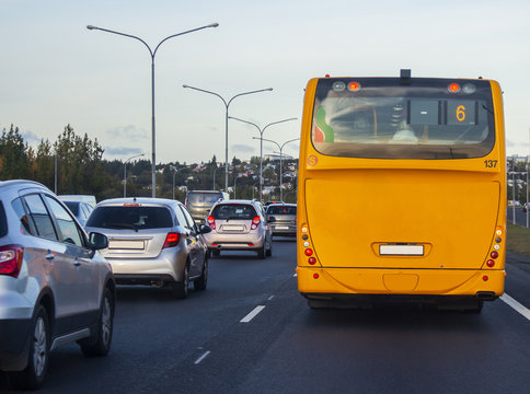 Behind a yellow bus