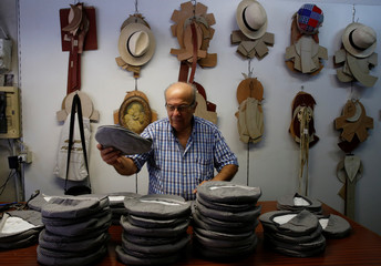 A man works at a hat shop in Palermo
