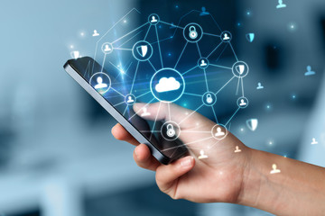 Hand using phone with centralized cloud computing system and network security concept