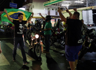 Protestors shout slogans in support of Presidential candidate Jair Bolsonaro in front of the Basilica of the National Shrine of Our Lady of Aparecida in Aparecida do Norte