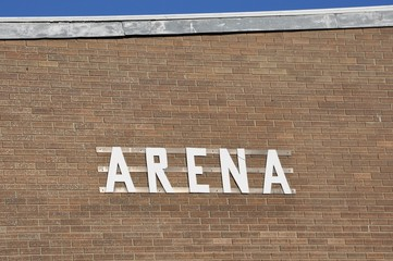 Arena sign posted on the brick wall
