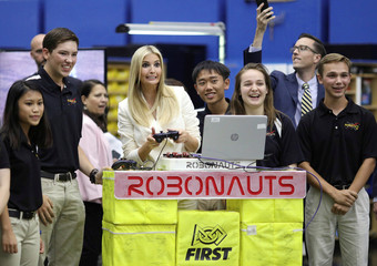 White House Senior Advisor Trump meets with local high school students involved in robotics competitions during a tour of the Johnson Space Center in Houston