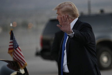 U.S. President Donald Trump arrives for a campaign rally at the airport in Las Vegas