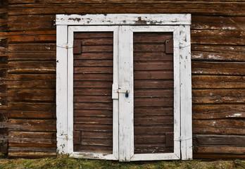 Old Brown Double Door and White Door Frame