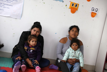 Mothers and children take part in an early stimulation workshop in Lima