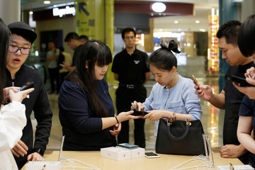 A customer pays after Apple's new iPhone XS and XS Max went on sale at the Apple Store in Beijing
