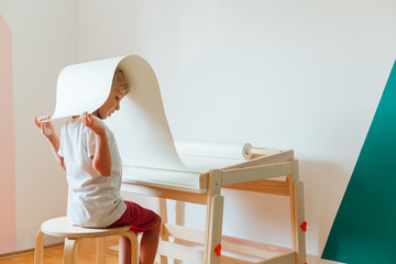 Boy using new wooden table