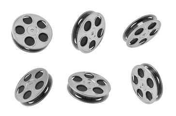 3d rendering of six black movie tape reels in different angles on white background.