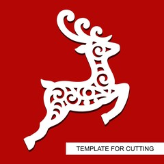 Christmas decoration - lace deer. Reindeer silhouette. Template for laser cutting, wood carving, paper cut and printing. New Year theme. Isolated object. Vector illustration.