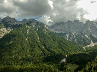Aerial view of beautiful Triglav mountains, part of Alps in Slovenia. Beautiful clouds on top of mountains.