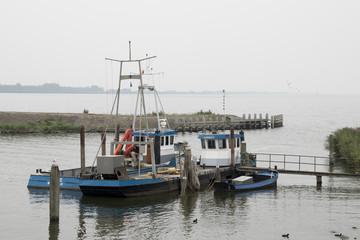 Fishing boat mooring in the harbor