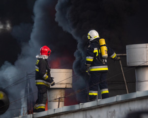 firefighters during the action of extinguishing a powerful fire of a recycling company.Poland, Szczecin