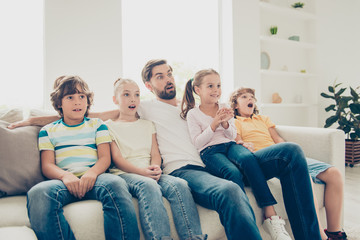 Relax, rest, chill daddy day concept. Portrait of four kids and
