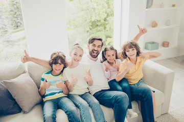 Positivity, careless, carefree four kids and father raised fists