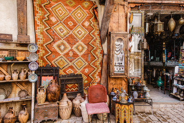 A souvenir shop in Fez, Morocco selling beautiful things like rugs, antiques, pottery and jewelry