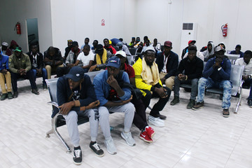 Migrants from Mali wait at Misrata airport before their return to their countries, in Misrata