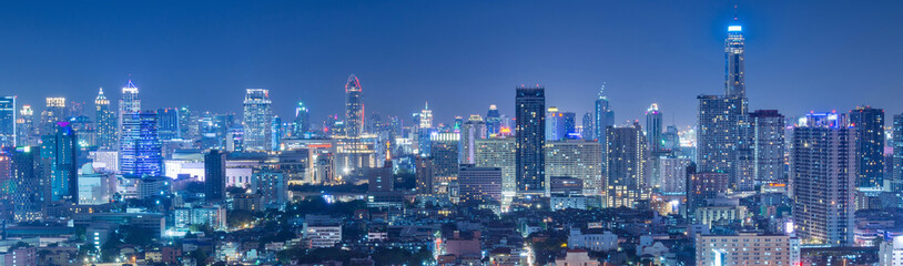 Bangkok business and travel landmark famous district urban skyline aerial view at night.