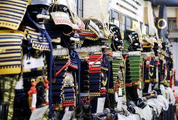 Samurai helmets and armors are displayed at Samurai Armor Kozando shop in Tokyo