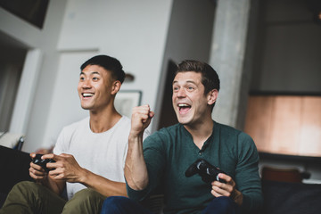 Male friends playing on a games console
